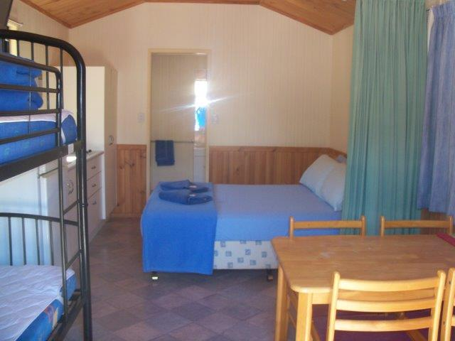 Villas are equipped with a double bed and two bunks 100_2578