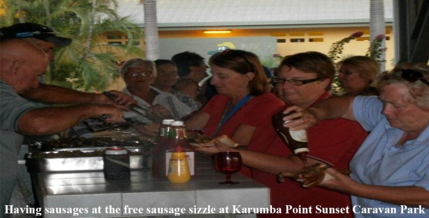 Having-sausages-at-the-free-sausage-sizzle-at-Karumba-Point-Sunset-Caravan-Park2